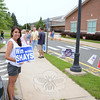 Campaign volunteer Laura Almonacid holds her sign Tuesday morning. (Bobowick photo)