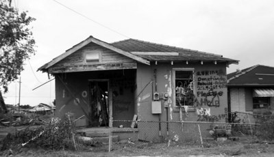 A plea for Help, spray painted on a damaged home in the Lower Ninth Ward.