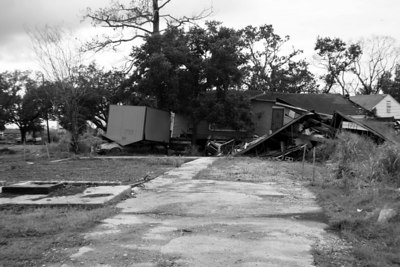 Damaged home in the Lower Ninth Ward, taken one year after hurricane Katrina. The shed is sitting on top of an automobile.