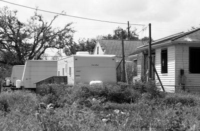 Fema Trailers On front lawns line Neighborhood streets.