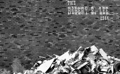 Debis piled high on the side of an apartment complex.
