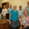 Town officials join representatives of the regional SCORE — the Service Corps Of Retired Executives — which is opening its fourth satellite office at the Newtown Municipal Center in the coming weeks. Pictured from left are Chapter Chairman Joe Eisenberg, Newtown Community Development Director Elizabeth Stocker, Newtown SCORE liaison Wes Thompson, counselor Cathy Lindstrom, Regional Branch Chairman Gerry Casiello, First Selectman Pat Llodra, and counselor Phil Lindstrom.   (Voket photo)
