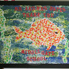 Middle Gate students had created a piece of art for Don and Donna the Bateses, a framed image of a fish that incorporated more than 350 student thumbprints, to say Thank You for the donation of a new fish tank for their school's library.  (Hicks photo)
