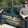 Newtown Police Department's Traffic Division Officers Jeff Silver, left, and Steve Ketchum spend their weekly shifts working to keep the community's roadways safe, whether by monitoring speed enforcement, distracted drivers, or performing vehicle safety inspections. Both officers say that summer weather seems to bring out the worst in some drivers who disregard posted speed limits or operate erratically putting other drivers, cyclists, and pedestrians at greater risk.   (Voket photo)