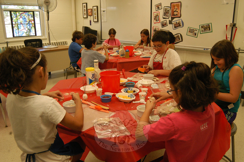 Students in Parks & Recreation's Food Fun for the Summertime worked during the first day of the program on Monday, July 9, to make buffalo chicken dip.   (Hallabeck photo)