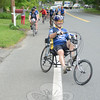 Muddy Angels riders arrive at the Newtown Ambulance Corps garage at 77 Main Street Wednesday, May 22. The group arrived in Newtown four days into their 2013 East Coast ride, a long distance cycling event that honors EMTs and paramedics who have become sick, injured or were killed while performing their duties. The stop in Newtown honored local EMS providers who were involved in the events of 12/14.   (Bobowick photo)
