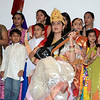 Alisha Aggarwal is flanked by many young students of the Greater Danbury Hindi Learning Center as she poses with an electric Vina as Saraswati, the Goddess of knowledge, music, and arts. (Voket photo)