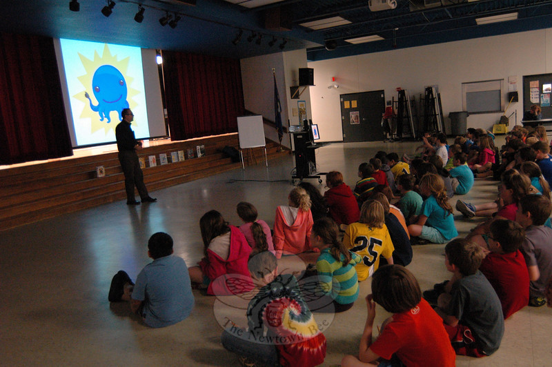 "A day before a ""Turning the Page, New Stories for Newtown"" event was held at Newtown Middle School for residents, authors and illustrators arrived in the school district on Friday, May 17, to visit with students. Dan Yacarrino spoke to Head O' Meadow School students. (Hallabeck photo)"