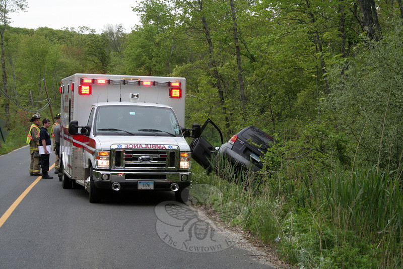 Newtown Volunteer Ambulance Corps members, Dodgingtown volunteer firefighters, and police responded to a one-vehicle accident about 5:22 pm on May 18 on Key Rock Road, near its intersection with North Branch Road. Police said that motorist Thomas J. Sharpe III, 25, of 20 Sunnyview Terrace was driving a 2006 Ford Escape SUV on Key Rock Road when he lost control of the vehicle and it went off the right road shoulder, landing in a ditch. There were no injuries. Police said they issued Sharpe an infraction for making a restricted turn and for illegal use of a handheld electronic device while driving. (Hicks photo)