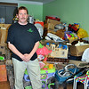 Mike Thomas, donation center attendant, stands by a pile of toys and home accessories at the Big Brothers Big Sisters Donation Center on South Main Street, which opened in March. As Newtown residents realize the convenience of the Big Brothers Big Sisters Donation Center, more and more donations of clothing and household items are being taken in to support the mentoring program, says Mr Thomas. (Crevier photo)