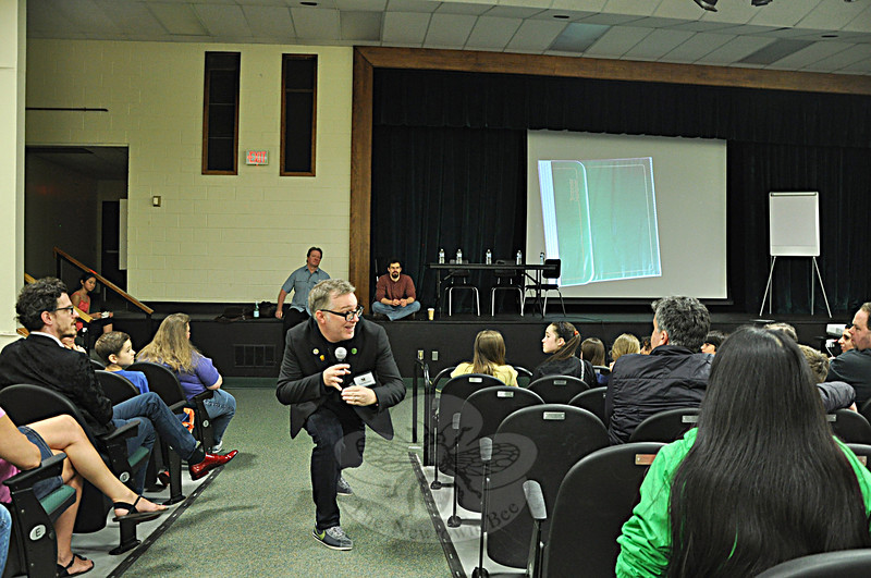 "Tony DiTerlizzi, author of the Spiderwick Chronicles, delivers an entertaining performance in the Newtown Middle School auditorium on Saturday, May 18, during ""Turning the Page, New Stories for Newtown."" (Dietter photo)"
