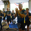 Muddy Angels riders stopped for refreshments and a ceremony at the Newtown Ambulance Corps garage where local services emergency personnel and town officials lined up to greet them.  (Bobowick photo)