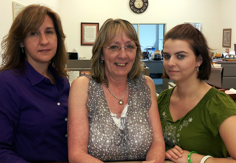 Newtown Assistant Town Clerks, from left, Renee Weimann, Monica Duhancik, and Aileen Nosal are supporting Town Clerk Debbie Aurelia in hopes that the legislature will take up and pass a bill that would limit the amount of information available to the public and press on state death records.  (Voket photo)