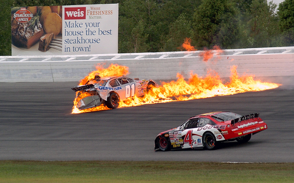 BLAINE FALKENA/Hazleton Standard-Speaker<br /> Car 4 driven by Tayler Malsam slows as Germain Toyota car  01 driven by Chrissy Wallace explodes into flame after sliding into the wall on Turn 1 Saturday, August 2nd, 2008 during the ARCA Re/Max Pennsylvania 200.