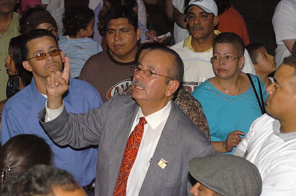 BLAINE FALKENA/Hazleton Standard-Speaker<br /> Agapito Lopez explains to the crowd outside what transpired inside City Hall Thursday night, July 13th, 2006 where Hazleton City Council passed the Illegal Immigration Relief Act.