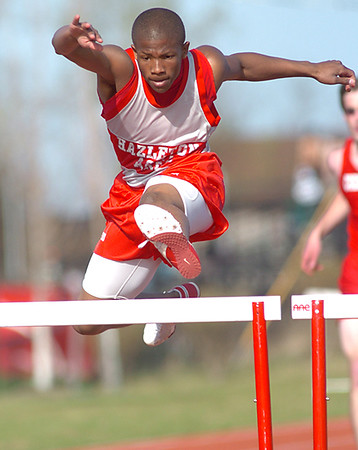 BLAINE FALKENA/Hazleton Standard-Speaker<br /> Hazleton Area's Donald Pollitt clears a hurdle during the 300 hurdles to finish first with a time of 42.8 seconds Thursday, April 24th, 2008 at Hazleton Area against Crestwood.