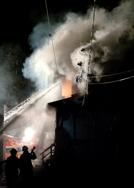BLAINE FALKENA/Hazleton Standard-Speaker<br /> Firefighters work to extinguish a fire at Second and Pardee Streets in Weatherly Tuesday night, April 16th, 2008.