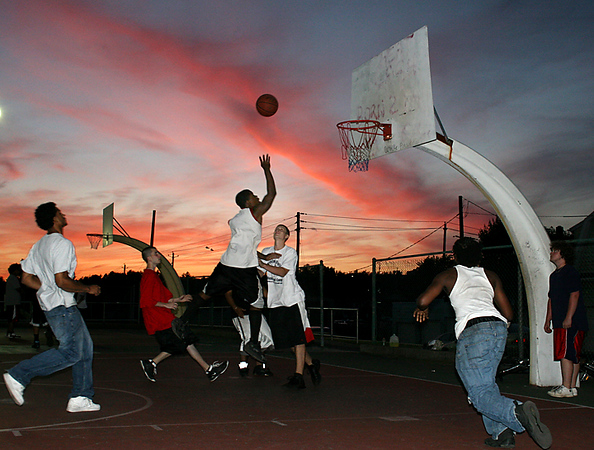 BLAINE FALKENA/Hazleton Standard-Speaker<br /> J. C. Milton shoots and scores during a pickup game at the Beech Street playground beneath a glowing sunset Tuesday evening, June 24th, 2008