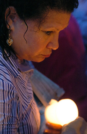 BLAINE FALKENA/Hazleton Standard-Speaker<br /> Anna Arias holds a candle during a vigil Wednesday night, July 12, 2006 denouncing the Illegal Immigration Relief Act that will be voted on Thursday during a city council meeting. Arias has been an outspoken opponent of the measure.