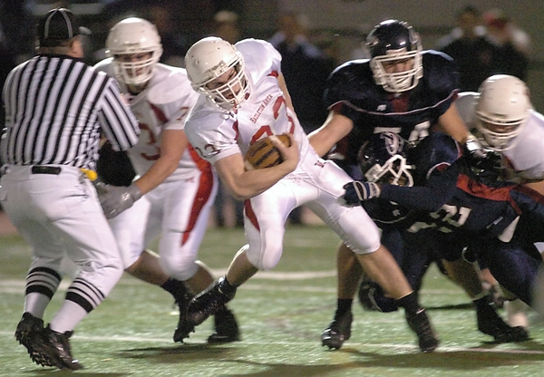 BLAINE FALKENA/Hazleton Standard-Speaker<br /> Hazleton Area's Nate Eachus (33) shrugs off a tackle by Liberty's Ahkeem Smith Friday night, November 16th, 2007 in Bethlehem.