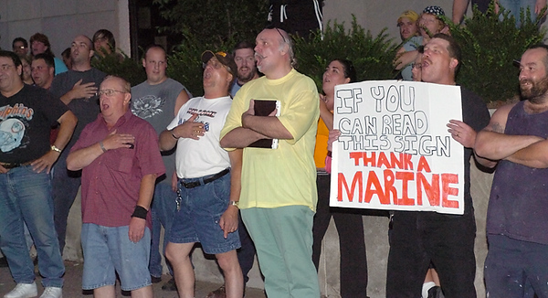 "BLAINE FALKENA/Hazleton Standard-Speaker<br /> Supporters of the Illegal Immigration Relief Act broke into a chorus of ""God Bless America"" followed by chants of ""we want ICE, we want ICE"" Thursday evening, July 13th, 2006 after the passage of the act by Hazleton's City Council."