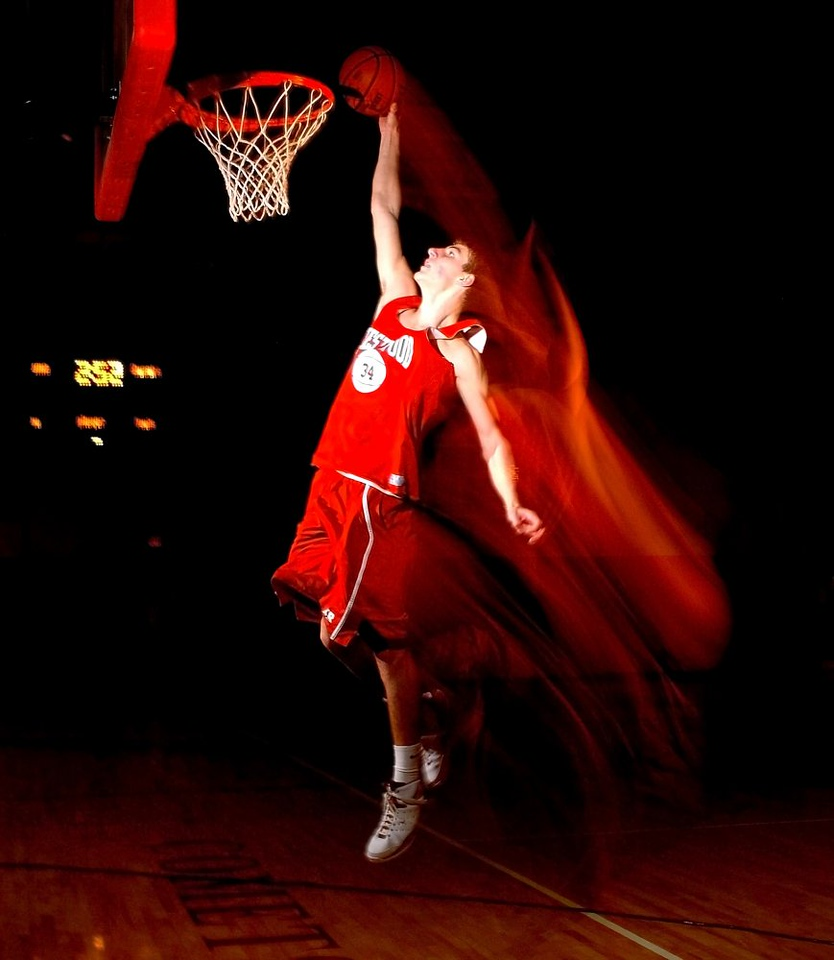 BLAINE FALKENA/Hazleton Standard-Speaker<br /> Crestwood High School Comets' Adam Fazzini dunks during practice Tuesday afternoon, November 25, 2008 (Thanks to Eric Bogumil for assisting).