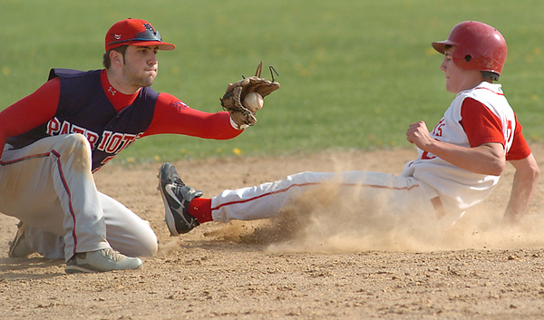 BLAINE FALKENA/Hazleton Standard-Speaker<br /> Crestwood High School's Derek Chrismer (22) makes it to second under the glove of Pittston Area's Carmen Lopresto (7) at Crestwood High School Monday afternoon, May 5, 2008 .