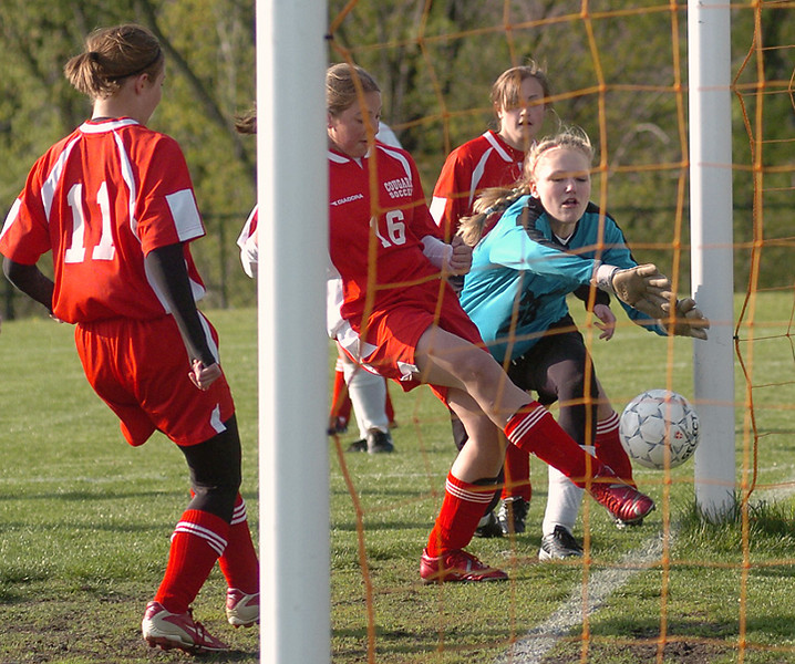 BLAINE FALKENA/Hazleton Standard-Speaker<br /> Nicole Kracom of Hazleton Area taps the ball into the net as MMI goalie Brone Lobichusky tries to stop her at Raiders Field Tuesday afternoon, April 29th, 2008.