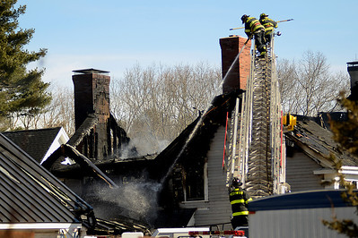 3/4/13 Westwood- Westwood and Dedham Fireman continue to fight a fire at 350 Dover Road Monday morning. Photo by Sean Browne, Westwood Press
