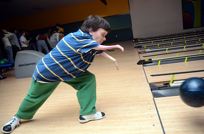 11/18/11 Milford- Connor Martell of Mendon rolls the ball down the alley during Friday evening's Teen's Night Out at Pinz in Milford. Photo by Sean Browne, Milford Daily News
