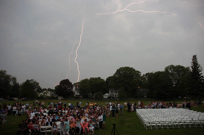 6/1/11 Dedham- Lightning streaks across the sky before the Dedham High School Graduation ceremony gets underway at the Endicott Estate. Photo by Sean Browne, Dedham Transcript