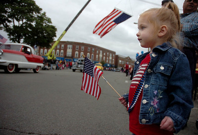 6/14/11- Dedham- Elizabeth Troisi, 2, of Dedham, waves her flag in Dedham Square as classic cars pass by during Tuesday evening's Flag Day Parade in Dedham. Photo by Sean Browne, Dedham Transcript