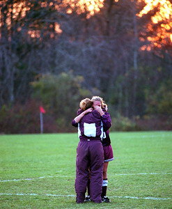 Dedham- Dedham captains Jordan Byrne and Rachael Leman hug each other in tears after losing in their second round tournament game at Old Rochester.  Photo by Sean Browne
