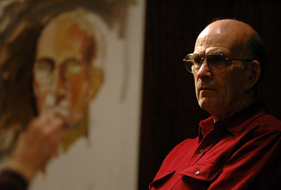 11/13/06 Dedham- Dedham Art Association member and raffle winner, Richard MacNabb, poses for an oil painting portrait by artist, Edwina Caci, during Monday evening's Art Association meeting and demonstration. Photo by Sean Browne, Daily News Transcript