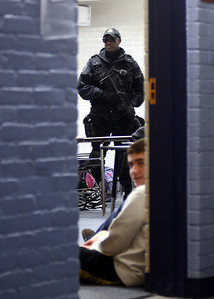 10/28/11 Walpole- Metropolitan Law Enforcement Regional Response Team member, Jim Lawrence, secures a room of students at Walpole High School during Friday morning's lockdown drill. Photo by Sean Browne, Walpole Times
