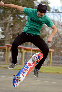11/28/11 Milford- Jesse Young of Ashland tries a kick flip at the Memorial School skate park Monday afternoon  in Milford. Photo by Sean Browne, Milford Daily News