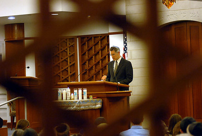 5/1/11 Sharon- Framed in the Magen David, Rabbi Joseph Meszler of Temple Sinai, reads out names of families who were lost and suffered through the Holocaust during Sunday evening's shared service at Temple Israel in Sharon. Photo by Sean Browne, Sharon Advocate