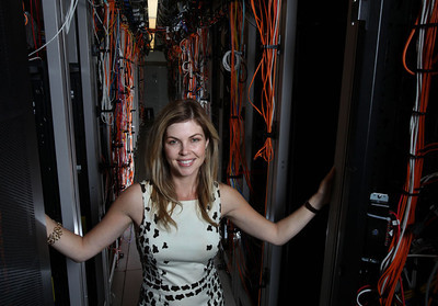Lori Wright, shown here in one of the company's server arrays, is the VP and general manager of Symantec Health, headquartered in Mountain View.  Silicon Valley-San Jose Business Journal/Dino Vournas