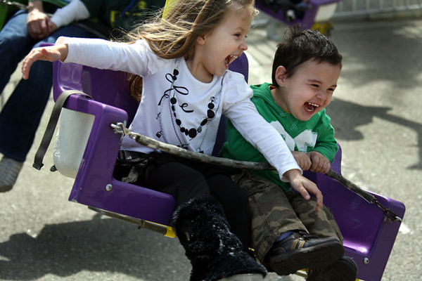 Kids get their thrills on a carnival ride at the City of Dublin's St. Patrick's Day Festival.