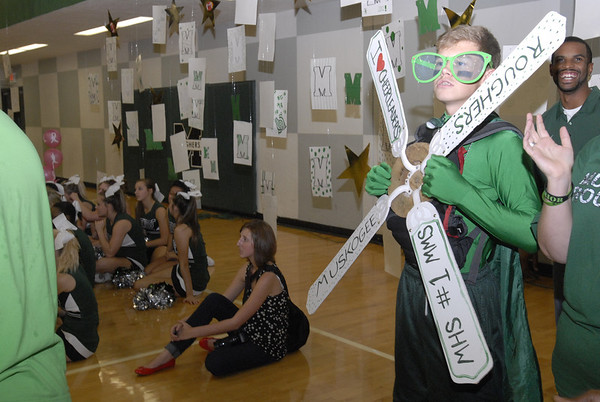 Muskogee High School junior Jordan Cunningham shows he's a Rougher fan during a pep rally and homecoming coronation Friday afternoon.