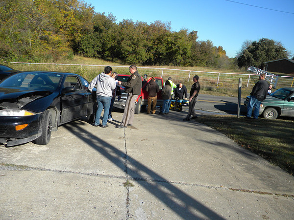 Personnel with the Muskogee County Emergency Medical Service prepare a gurney for a person involved in a two-car accident Nov. 7 on Harris Road. The accident occurred shortly after 9 a.m. on Harris Road between U.S. 69 and 11th Street. Oklahoma Highway Patrol trooper Todd Riggs said a red pickup was pulling out of a driveway on Harris Road. Riggs said that when the driver backed out, it blocked two lanes. He said the black car swerved to the left and struck the truck. No names were available. He said there were minor injuries.