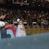 Muskogee High School senior homecoming attendant Hollie Moore helps Flower Girl Madison Grace Dillon find her way during the 2012 Homecoming Coronation.