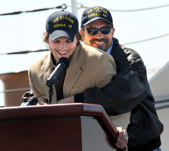 Actor Kevin Costner, right, gets playful with fellow actor Ashton Kutcher during an appearance at the Coast Guard Station in Alameda, Calif. to honor Guardsmen that had rendered exemplary and heroic service the past year.  The actors finished a movie called The Guardian, that has the Coast Guard as a central theme.  (AP Photo/Dino Vournas)