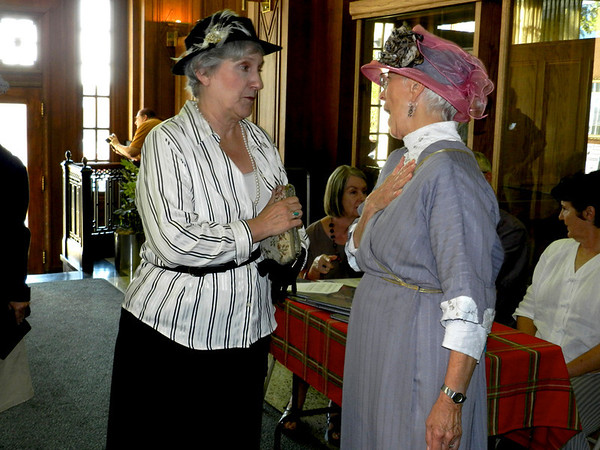 The Rev. Ann Brizendine as Eleanor Roosevelt, left, and Francie Fite as her great aunt, Nannie Daniel Fite, greet one another at the Severs Hotel gala Thursday.