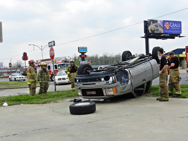 Emergency personnel stand near a pickup involved in a crash April 9, 2013, at the 32nd and Denver streets intersection. Muskogee Police Officer Don Johnson said a red Chrysler Town and Country van driven by Wayne Dial, 74, struck the pickup, a silver GMC Sierra driven by Cindy Pevehouse, 55.