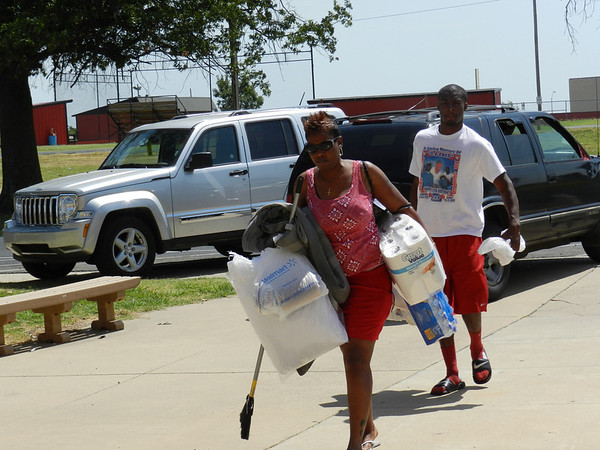 Houston resident Delta Scott leads her son Verriel Littleton to Posey Hall during the first day for students to move in at Bacone College. The college experienced a record number of applicants this year.