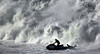 A water rescue officer picks up a surfer and tries to outrun a big wave at the Maverick's Surf Contest, Saturday, Feb. 13, 2010 in Half Moon Bay, Calif.  AP Photo/Dino Vournas