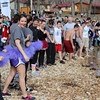 """Students and faculty from Kansas Public Schools prepare to plunge into the icy waters of the Illinois River. As they dove in, one student yelled loudly above the crowd, """"It's so cold!"""""""