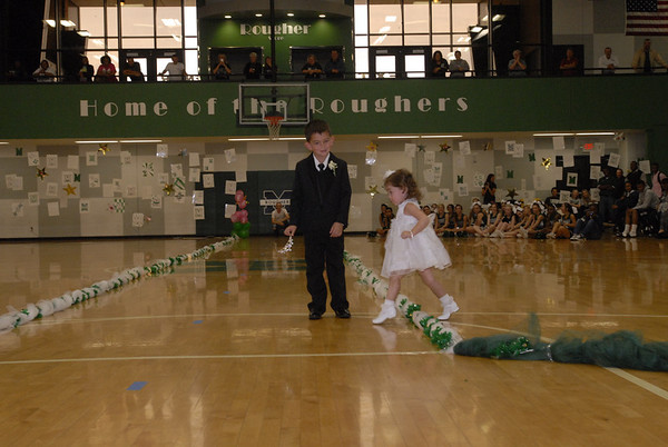 Crown Bearer Carson Coleman waits while Flower Girl Madison Grace Dillon finds her way during the 2012 Homecoming Queen coronation Friday.