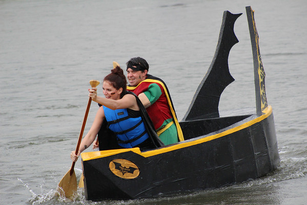 "The Creek Nation ""Bat-Pod,"" manned by Chris Sims and Sarah Gile races in the 2012 River Rumba Regatta."